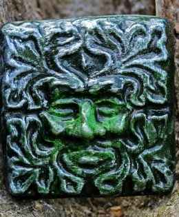 green man wall tile