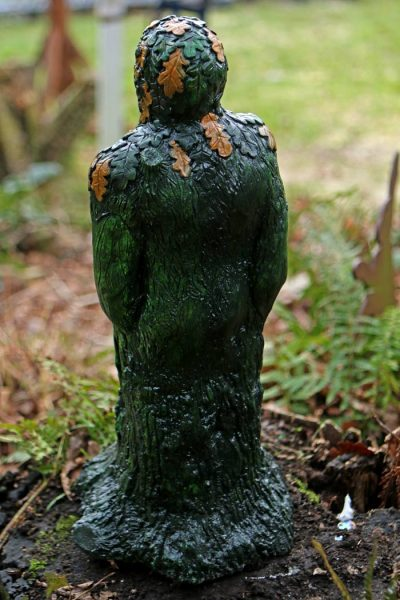 green-man-statue-back-view